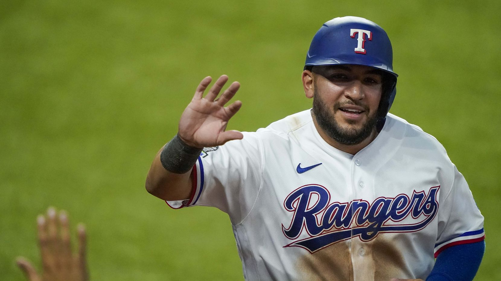 Catcher Jose Trevino celebrates after scoring a run in an intrasquad game during Texas Rangers Summer Camp at Globe Life Field on Saturday, July 18, 2020.