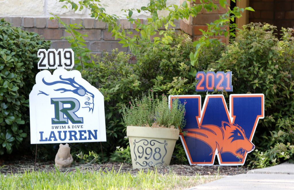 Yard signs at a home on Golden Camp Rd. in Frisco displays divided loyalties to high school on Thursday, August 2, 20018. (Stewart F. House/Special Contributor)