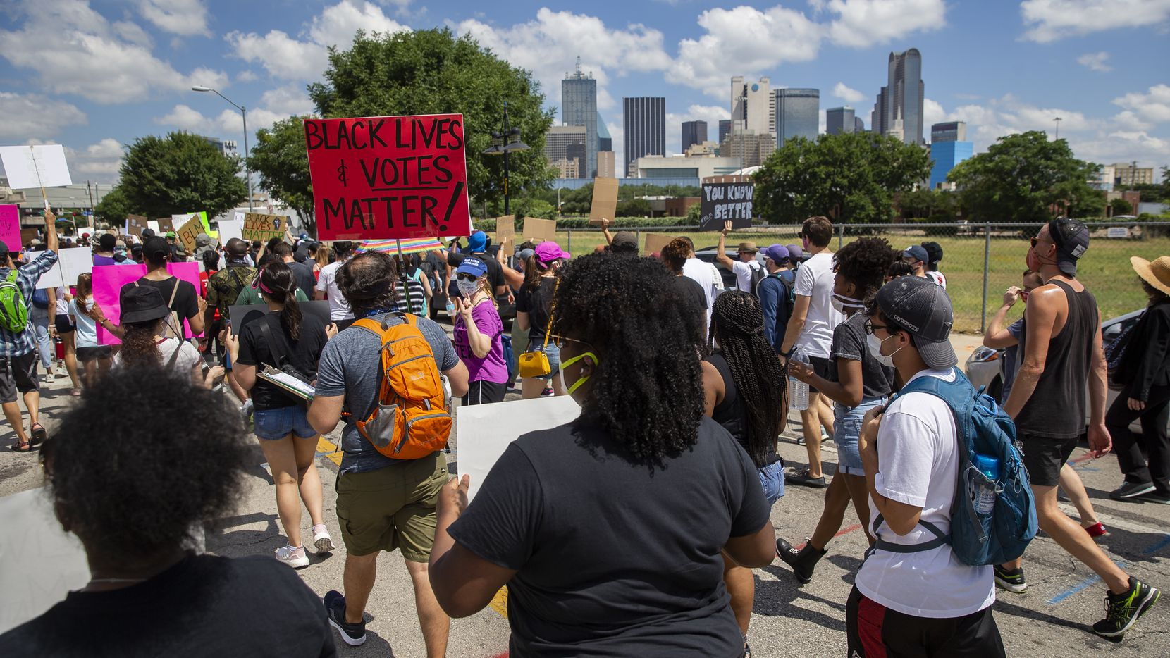 Protesters marched toward downtown Dallas during one of dozens of demonstrations against police brutality and the killings of African Americans that took place across North Texas on Sunday.
