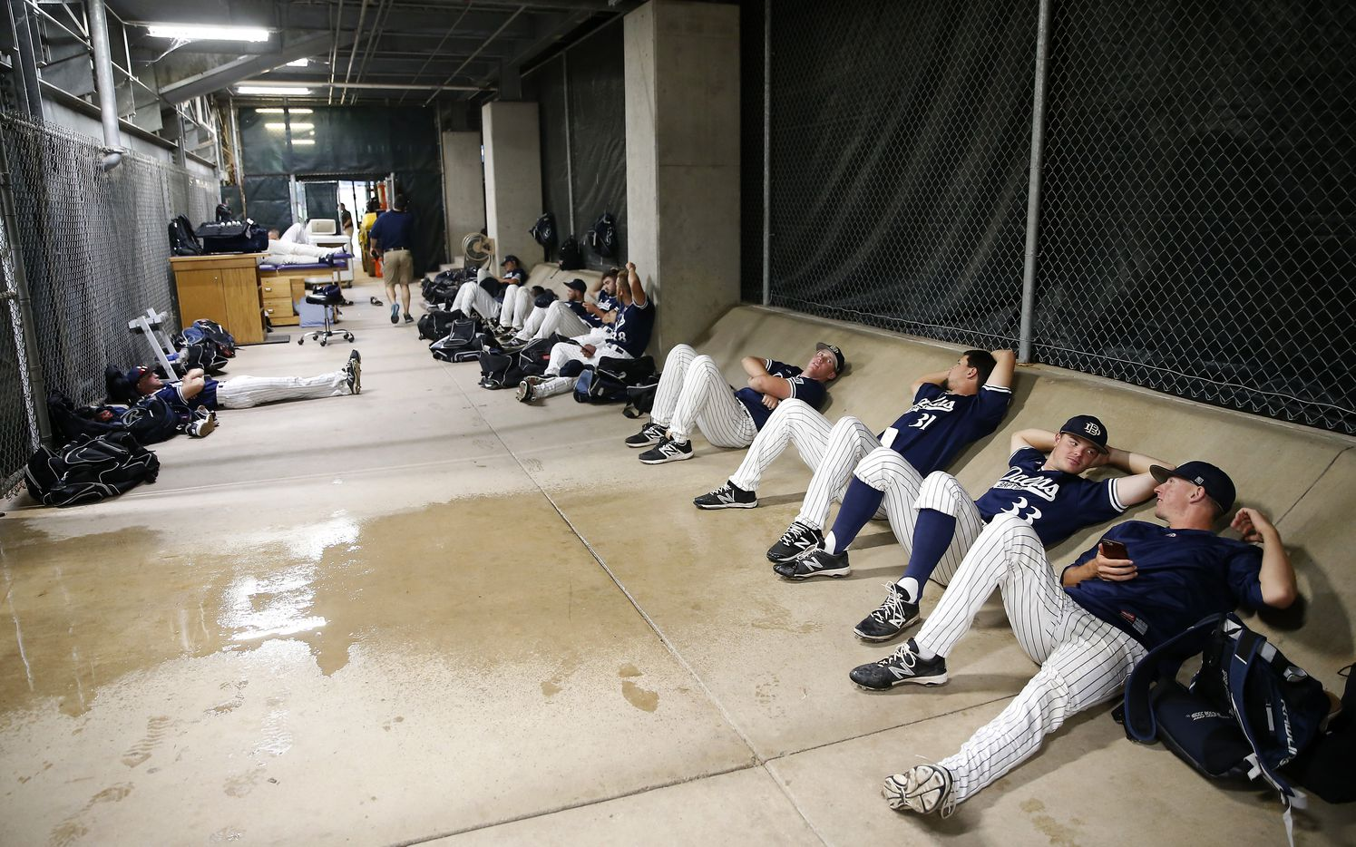 Dallas Baptist players wait under the stand during a rain delay in the NCAA Fort Worth Regional game against Virginia at Lupton Stadium in Fort Worth, Texas, Friday, June 2, 2017. (Jae S. Lee/The Dallas Morning News)