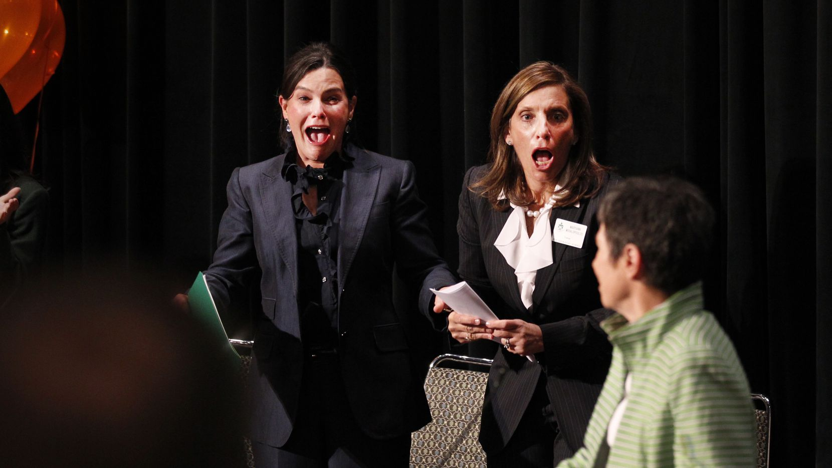 From left: Jeanne Whitman Bobbitt, headmistress of The Hockaday School, and Maryann Mihalopoulos, centennial campaign chair of the school, reacted as Lyda Hill announced that she was doubling her donation to the school from $10 million to $20 million in 2011.