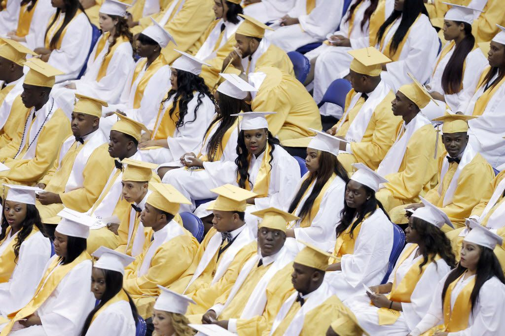 Members of the South Oak Cliff High School class of 2016 wait to receive their diplomas during a graduation ceremony at the Ellis Davis Field house in Dallas in May, 2016.