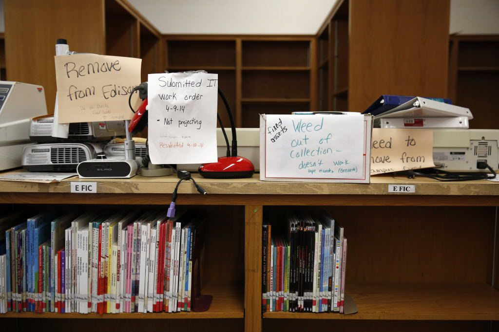 Broken equipment and empty book shelves in the library at Thomas A. Edison Middle Learning Center in Dallas on Oct. 15, 2015.  (Rose Baca/The Dallas Morning News)