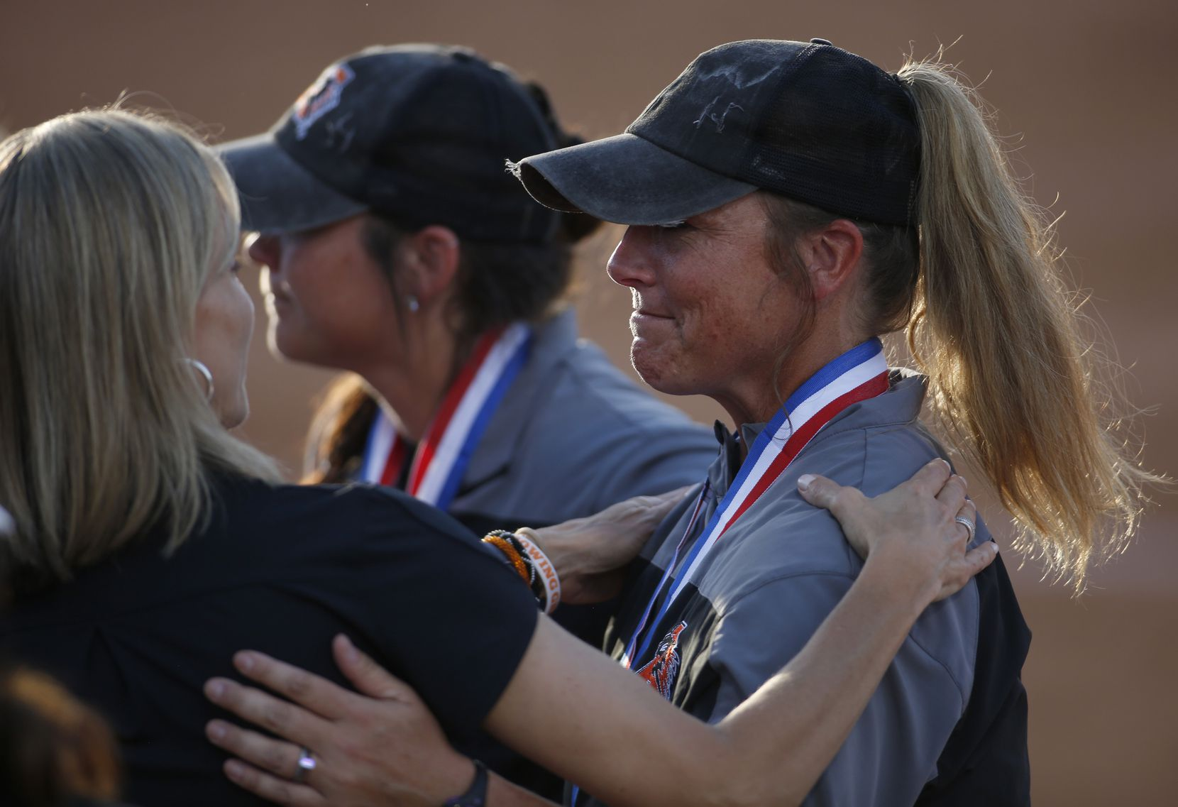 Aledo head coach Heather Myers, right, receives well wishes on the field following their 4-1 loss to Barbers Hill. The two teams played their UIL 5A state softball championship game at Red and Charline McCombs Field on the University of Texas campus in Austin on June 5, 2021. (Steve Hamm/ Special Contributor)