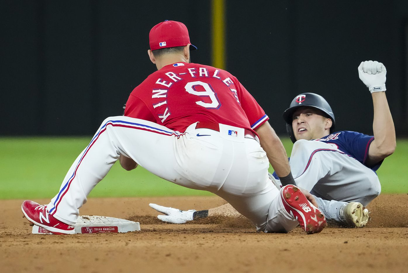 Minnesota Twins first baseman Alex Kirilloff is out at second base as Texas Rangers shortstop Isiah Kiner-Falefa waits with the tag during the ninth inning at Globe Life Field on Friday, June 18, 2021.