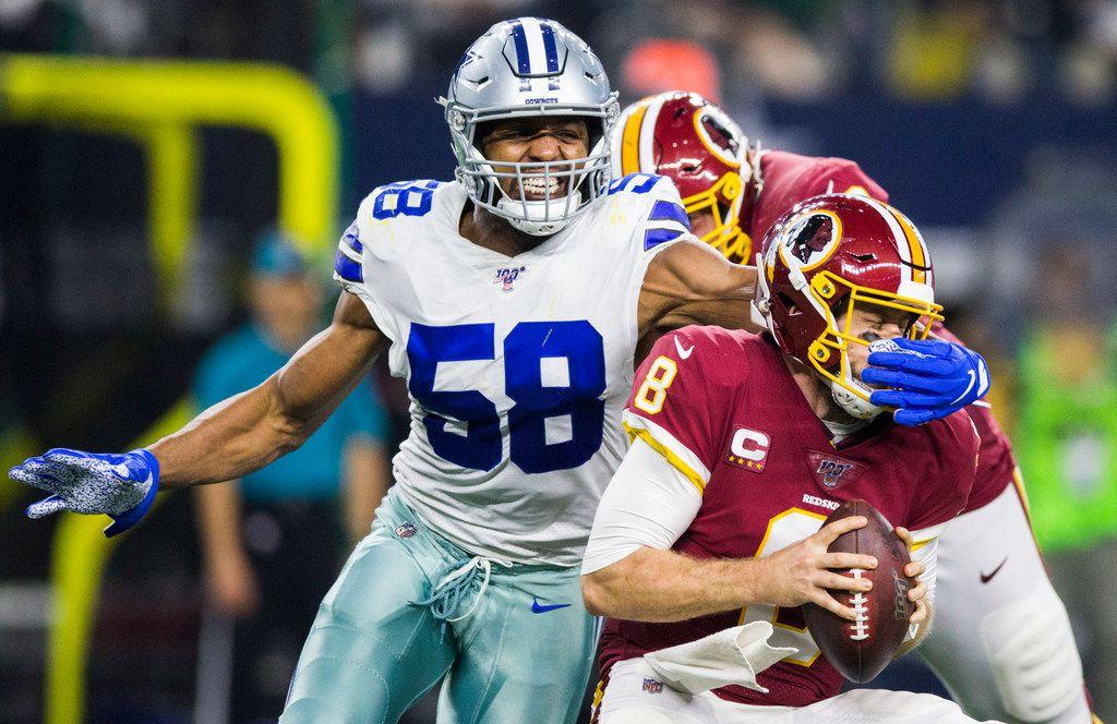 Dallas Cowboys defensive end Robert Quinn (58) sacks Washington Redskins quarterback Case Keenum (8) during the third quarter of an NFL game between the Dallas Cowboys and the Washington Redskins on Sunday, December 29, 2019 at AT&T Stadium in Arlington, Texas.