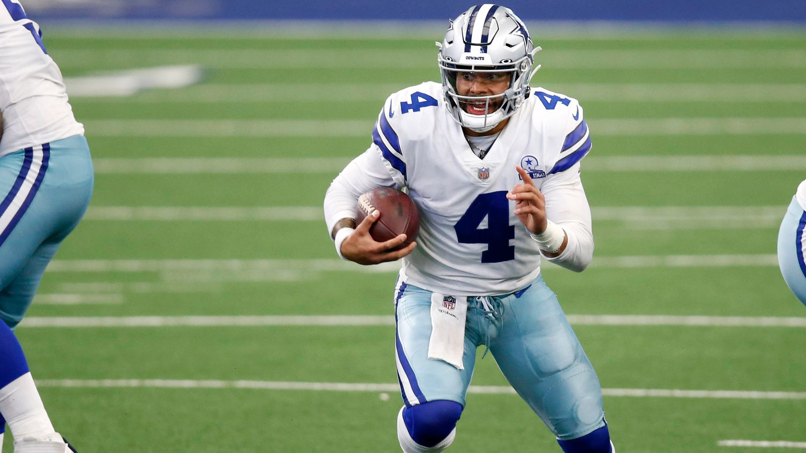 Dallas Cowboys quarterback Dak Prescott (4) runs up the field during second half of play against the Atlanta Falcons in the home opener at AT&T Stadium in Arlington, Texas on Sunday, September 20, 2020. Dallas Cowboys defeated the Atlanta Falcons 40-39.