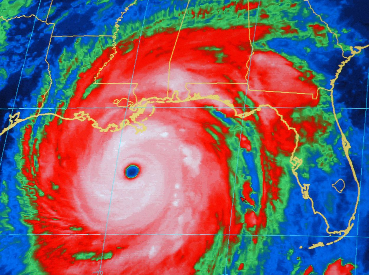 A National Oceanic and Atmospheric Administration infrared satellite images shows the outer bands of Hurricane Katrina, well ashore on the northern Gulf coast and the center of the storm about 165 miles, south-southeast of New Orleans at 8:15 p.m. CT Sunday, Aug. 28, 2005.