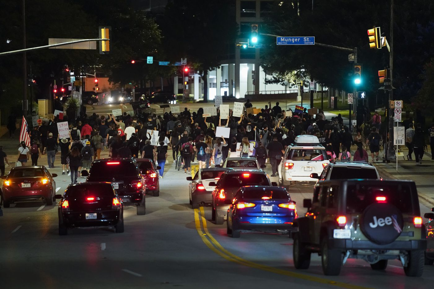 Traffic backs up as demonstrators march on Ackard Street in downtown Dallas after a Kentucky grand jury brought no charges against Louisville police for the killing of Breonna Taylor on Wednesday, Sept. 23, 2020.