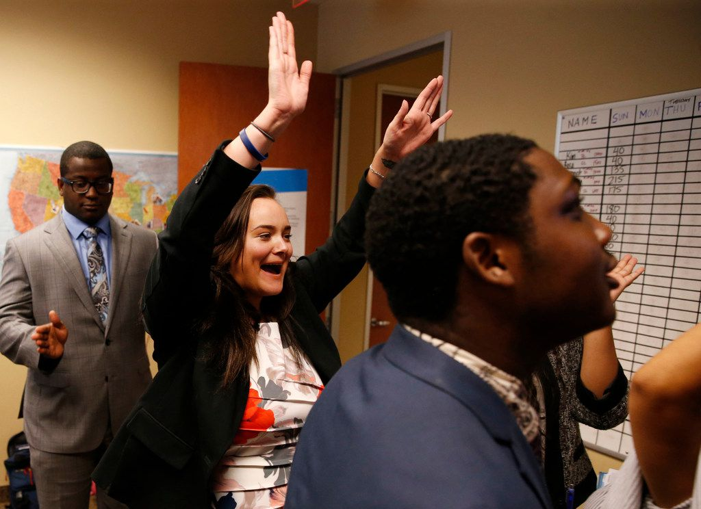 Hannah Magnuson celebrates after winning a monetary prize before a team meeting at Evantage in Plano.