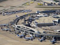 Aerial view of United, Delta and Spirit Airlines aircrafts at the gates of Terminal E at Dallas Fort Worth (DFW) International Airport on April 16, 2020. (Smiley N. Pool/The Dallas Morning News)
