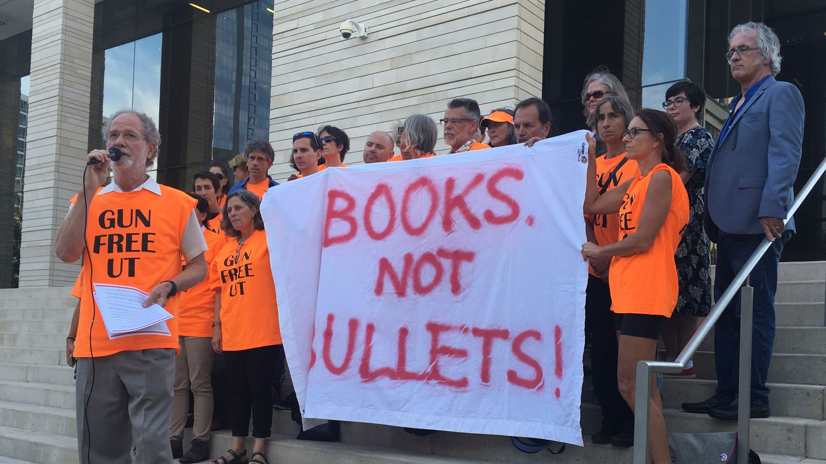 Professors and students from the University of Texas at Austin stood outside the U.S. District Court for the Western District of Texas on Thursday. Three UT-Austin professors are suing to temporarily block implementation of the state's brand-new campus carry law, which allows licensed gun owners to carry concealed handguns into most campus buildings.