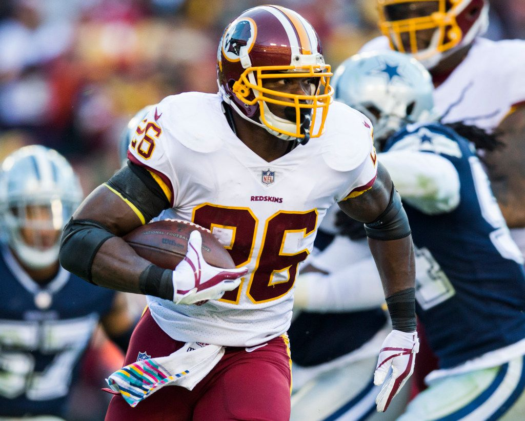 Washington Redskins running back Adrian Peterson (26) runs the ball during the first half of an NFL game between the Redskins and the Dallas Cowboys on Sunday, October 21, 2018 in Landover, Maryland.