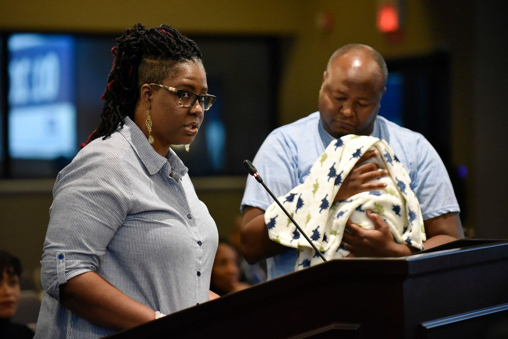 Tonya Muraguri (left) with her husband, Kaburu Muraguri, and baby  Kayden, speaks in favor of creating a paid parental leave program for city employees in DeSoto during a City Council meeting on Tuesday at the Jim Baugh Government Center. The council voted in favor of creating the program to pay city employees for parental leave.