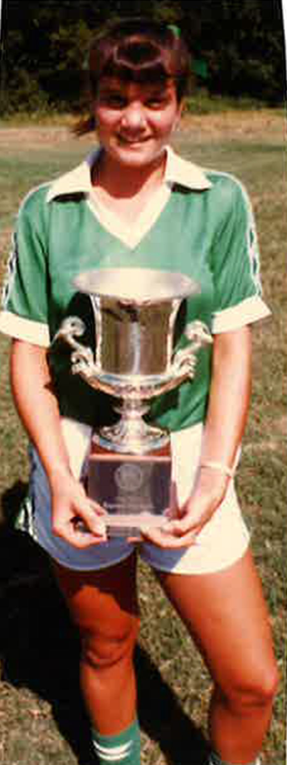 Laura Anton poses with the team's trophy after the D'Feeters Soccer Club won a regional championship in North Carolina in June 1983.