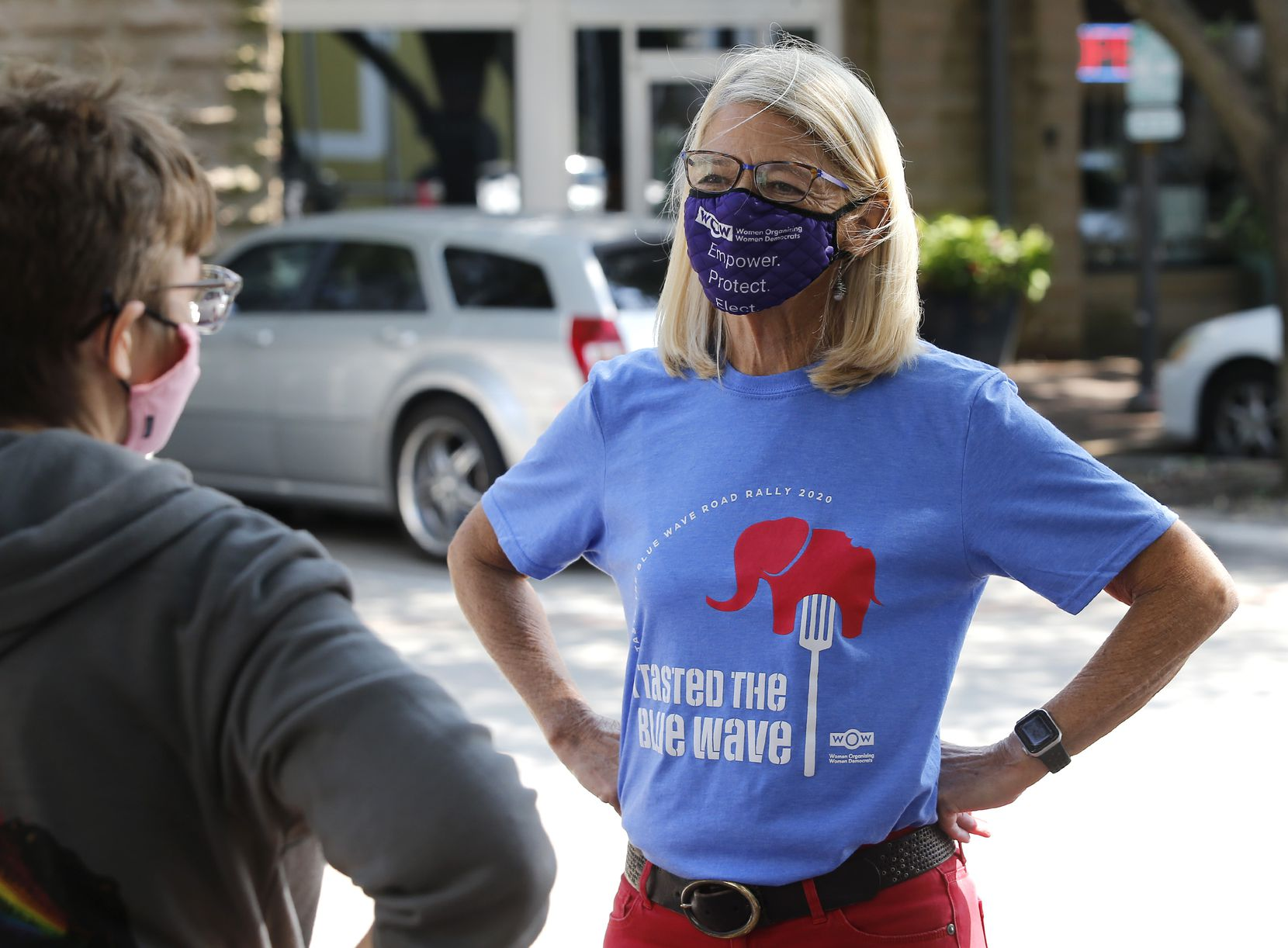 Sharon Hirsch, a Democratic candidate for the Texas House, talks with a volunteer during a drive-up rally at the Shops at Legacy in Plano.