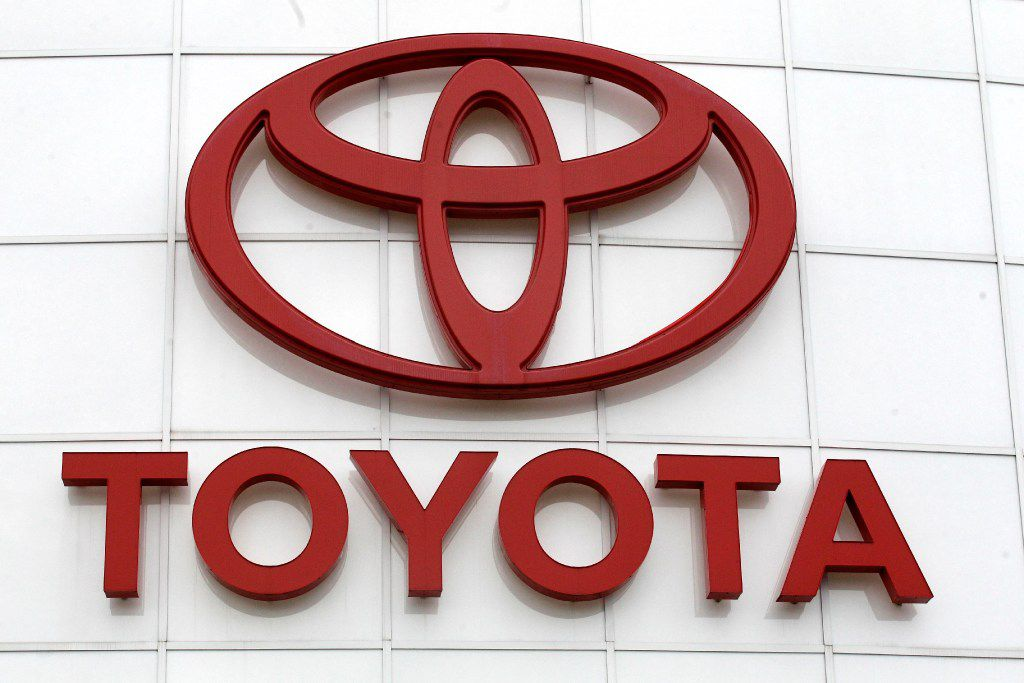 FILE - This March 30, 2011, file photo, shows the Toyota logo at Wilsonville Toyota, in Wilsonville, Ore. On Tuesday, Jan. 24, 2017, Toyota Motor Corp. said it's recalling about 79,000 Tundra pickup trucks in the U.S., Canada and Central America because steps in the rear bumpers could break. The recall covers trucks from the 2016 and 2017 model years. (AP Photo/Rick Bowmer, File)