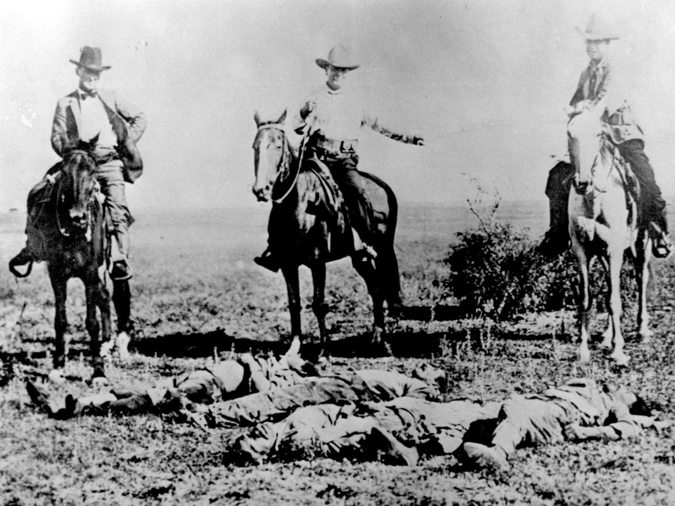 "In the early 1900s along the Mexican border, the Rangers killed hundreds of Mexicans and Mexican-Americans. This postcard celebrated the deaths of ""Mexican Bandits."" This is a photograph from Doug J. Swanson's new book, ""Cult of Glory: The Bold and Brutal History of the Texas Rangers."""