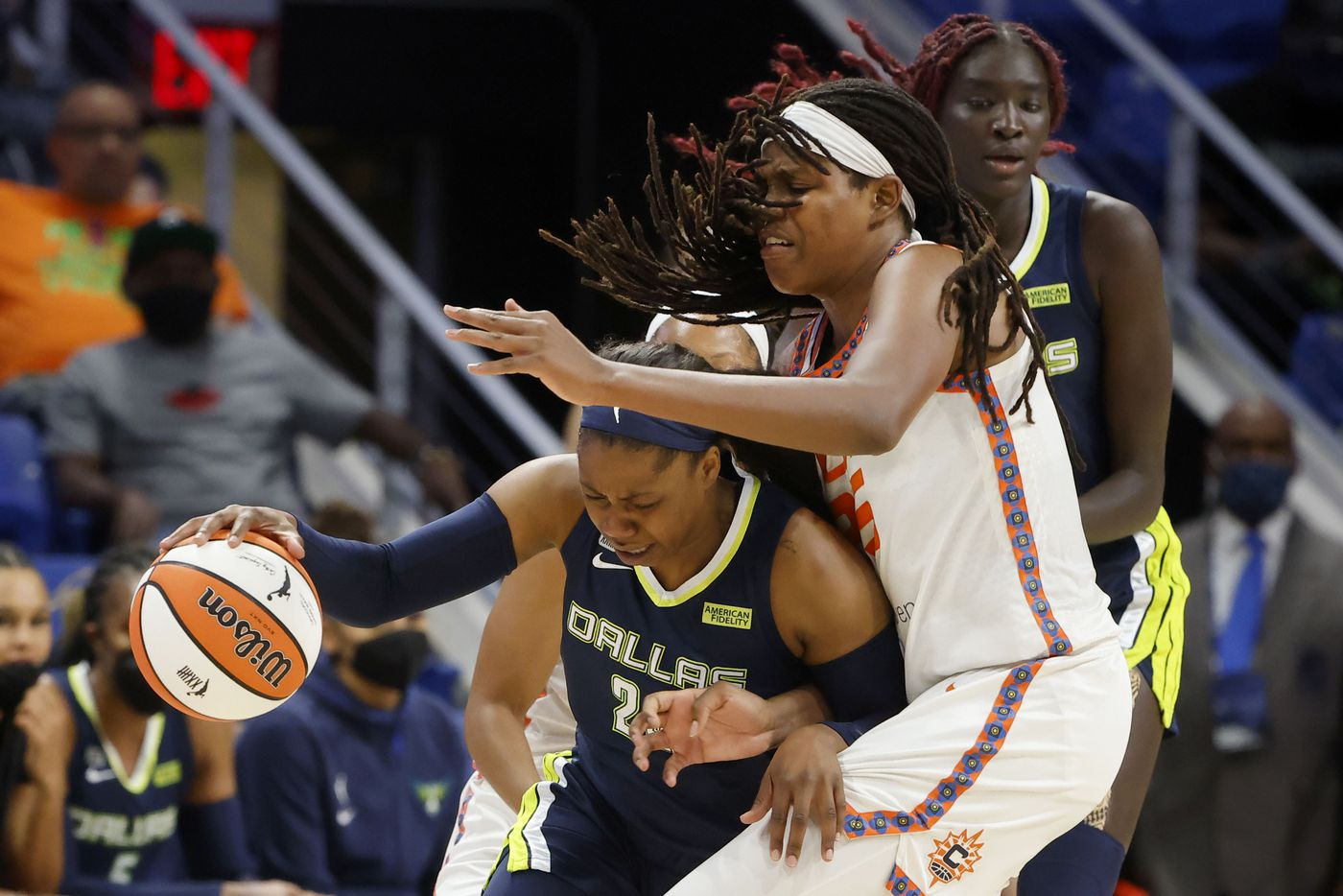 Dallas Wings guard Arike Ogunbowale (24) tries to get past Connecticut Sun forward Jonquel Jones (35) during the first half of a WNBA basketball game in Arlington, Texas on Tuesday, Sept. 07, 2021. (Michael Ainsworth/Special Contributor)