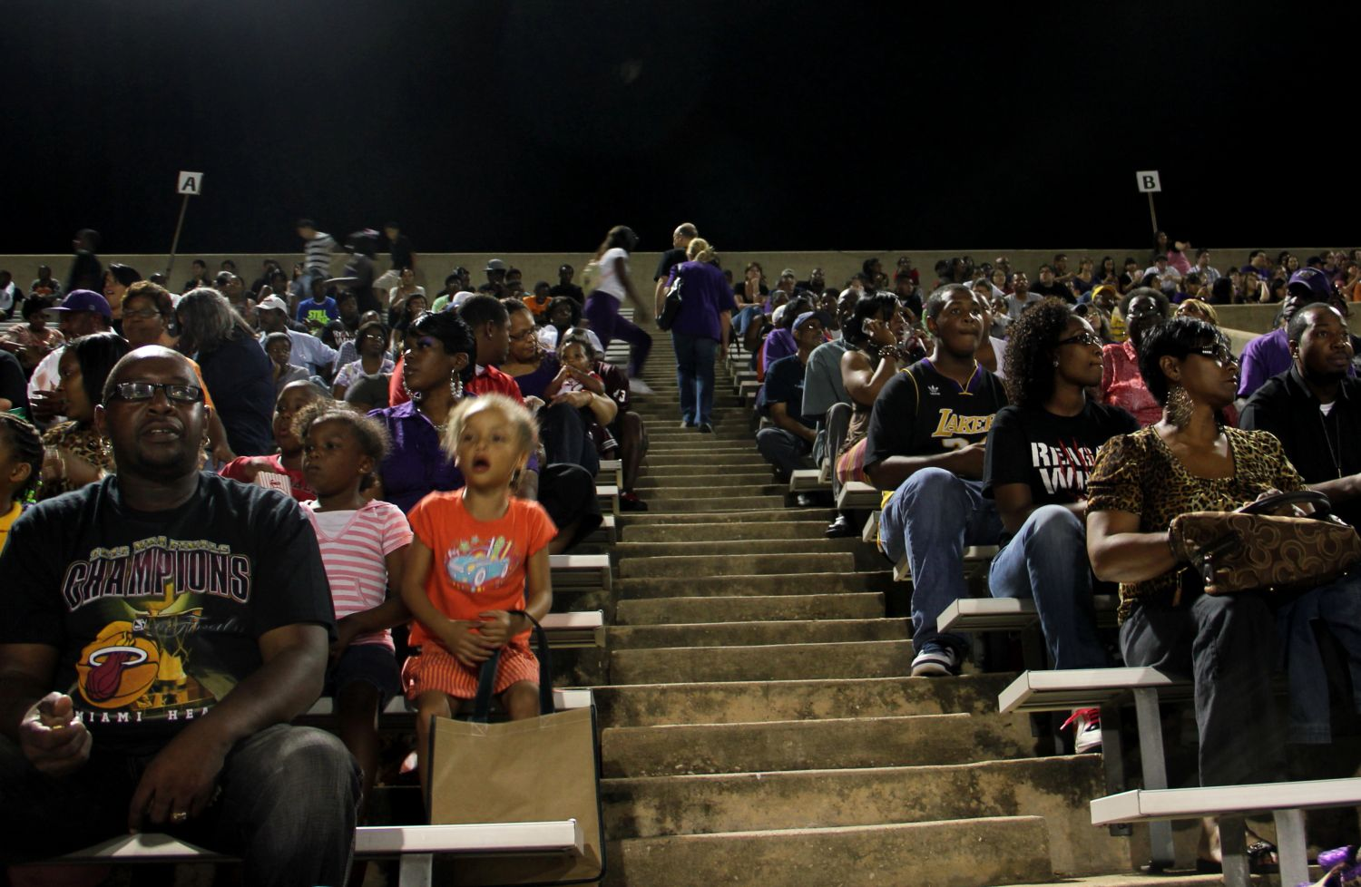 LBJ students and parents watch an LBJ-Reagan football game in Austin, Texas. According to attendees, LBJ and LASA students and parents most often sit in separate sections of the stadium.