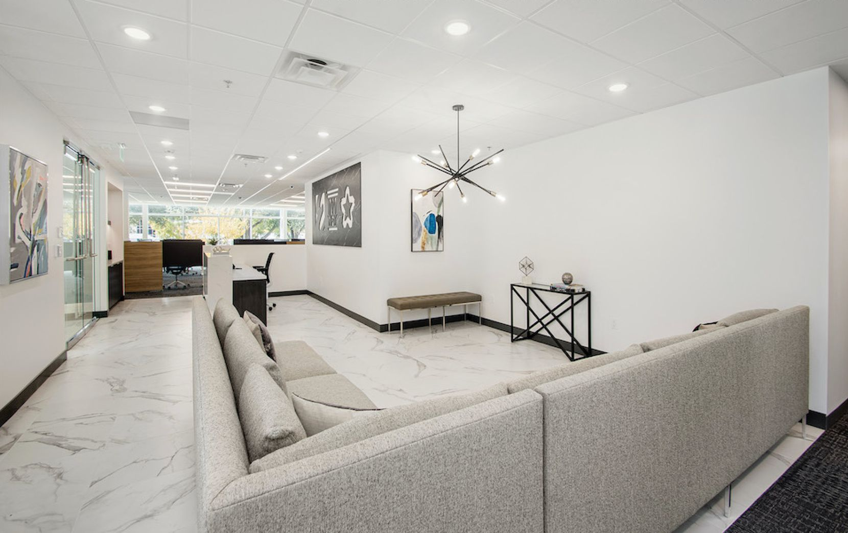 """Ebby Halliday's new headquarters has 17,000 square feet of space, about half of what the company previously occupied. The choice of a smaller office was deliberate and a response to """"today's modern work environment and needs,"""" the company says."""