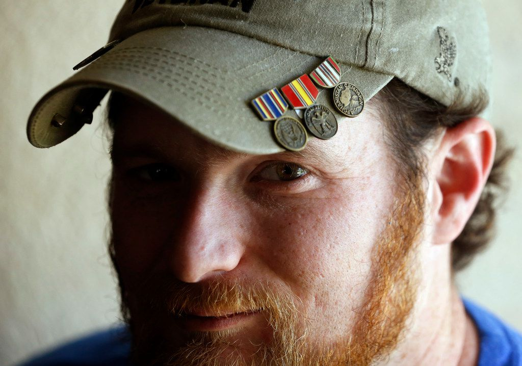 Joshua Raines poses for a portrait in his home in Springtown, Texas, on Thursday, June 13, 2019. Raines is a Purple Heart recipient and a former Army soldier who did tours in Iraq and Afghanistan. After surviving a bomb explosion in Afghanistan that left him with severe traumatic brain injury, he began having seizures and was diagnosed with PTSD when he returned to the U.S. He now uses CBD oil to control his seizures.