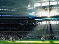 Sunlight steams through the windows of the stadium during the first half of an NFL football game between the Dallas Cowboys and the Washington Redskins at AT&T Stadium on Sunday, Dec. 29, 2019, in Arlington.