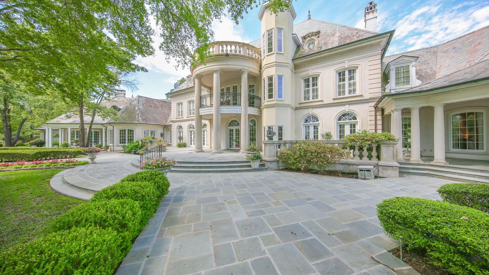 """The Pilgrim estate, known locally as """"Cluckingham Palace,"""" covers 43 acres and has an 18,000-square-foot French Renaissance-style mansion, six bedrooms and 10 and a half baths."""