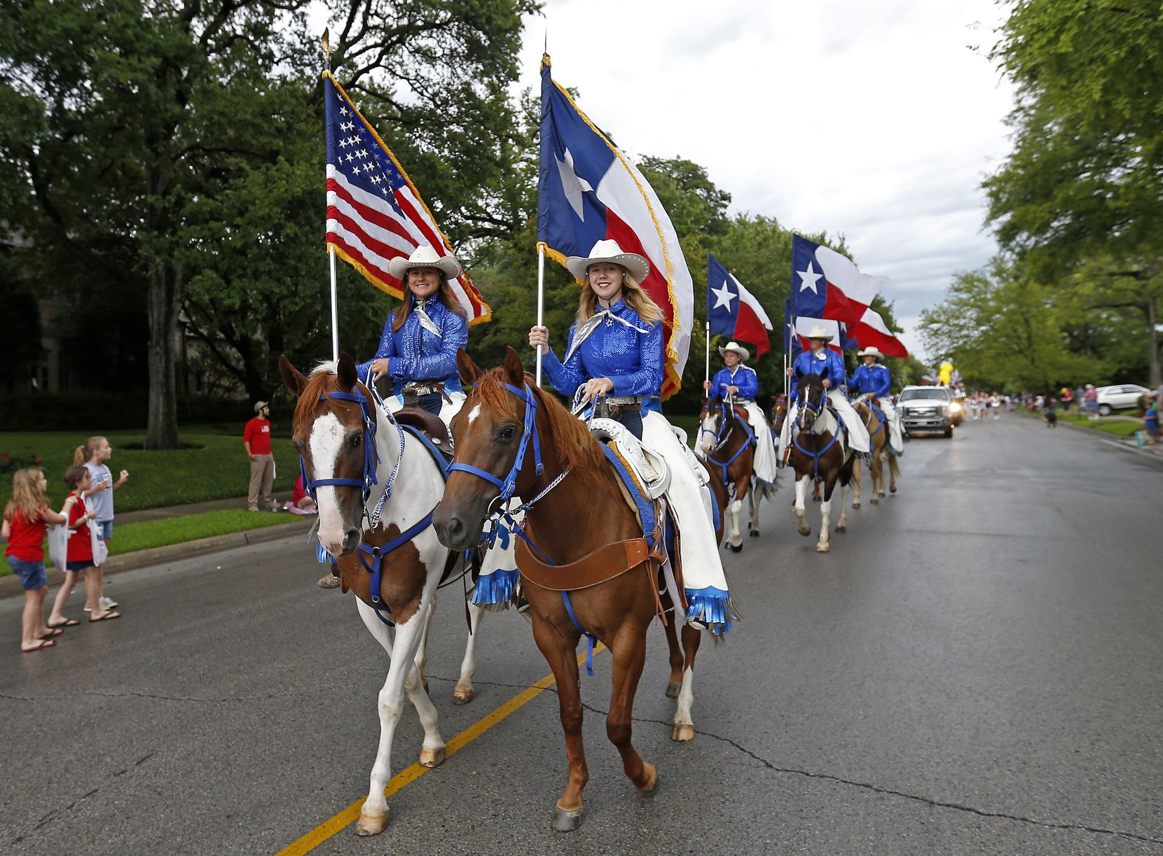 Parade participants will be back in the saddle for this year's Park Cities festivities, which kick off July 3. Last year's parade was among the many canceled.