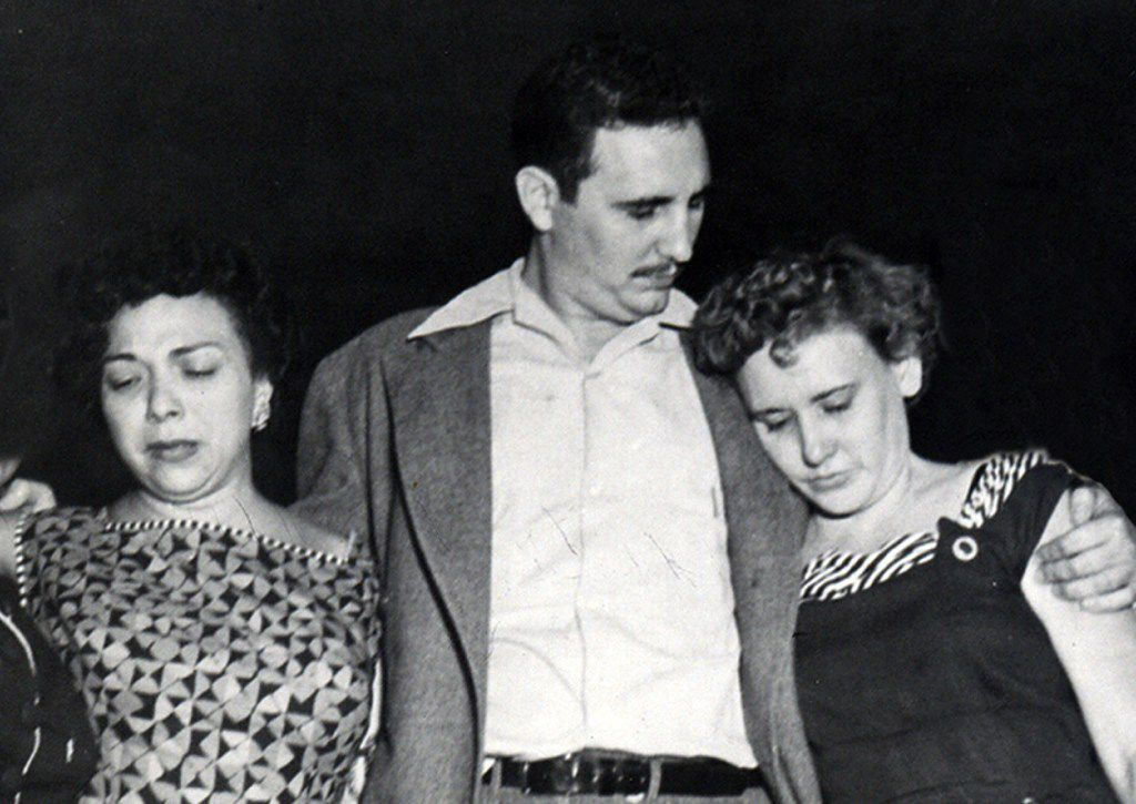 In this May 15, 1955 file photo, Fidel Castro (C) and his close and faithful collaborators Hayde Santamaria (R) and Melba Hernandez, leave the Presidio Modelo prison in Havana, after being pardoned under an amnesty by the then President Fulgencio Batista, in the case of their 1953 assault on the Moncada military barracks.