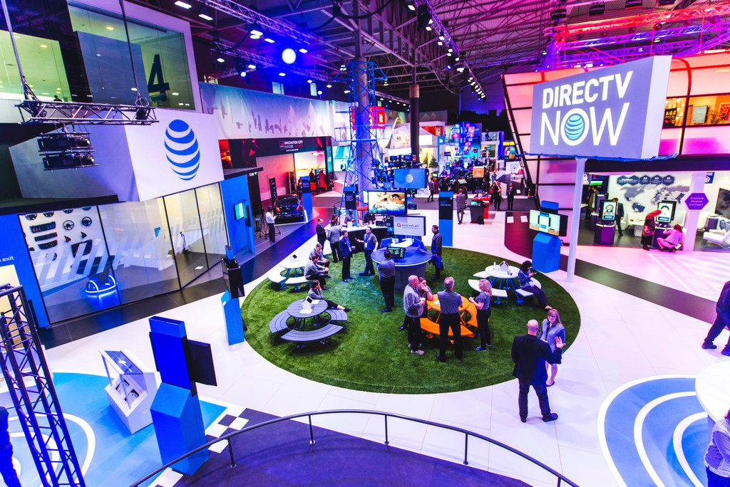 An undated photo of an AT&T and DirecTV NOW booth at a Mobile World Congress show. Mobile World Congress is an exhibition for the mobile industry, and a conference of prominent executives representing global mobile operators, device manufacturers, technology providers, vendors, and content owners.