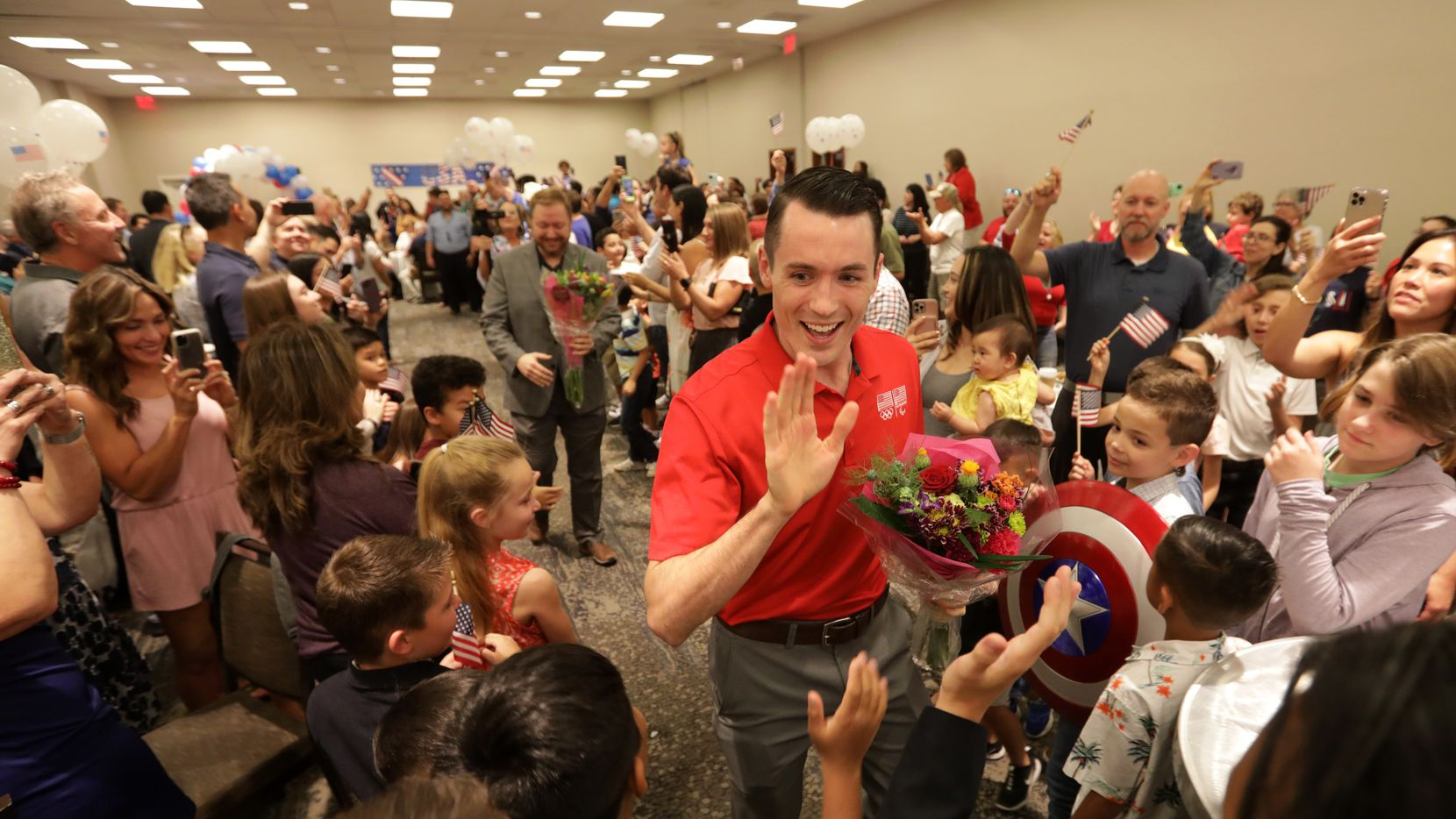 Tom Scott greets supporters during an Olympics sendoff party at The Westin Galleria in Dallas, TX, on Jul. 9, 2021.