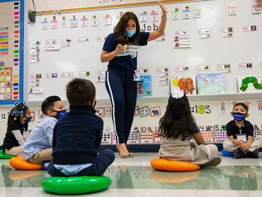Jerry R. Junkins Elementary teacher Alma Andrade teaches her class as students are spaced out on the floor in Carrollton. Irving ISD denied requests from about 150 staff members to work from home as the number of in-person learners increased.