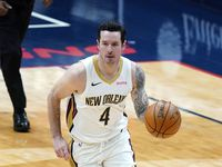 New Orleans Pelicans guard JJ Redick (4) moves the ball up court in the first half of an NBA basketball game against the Utah Jazz in New Orleans, Monday, March 1, 2021.