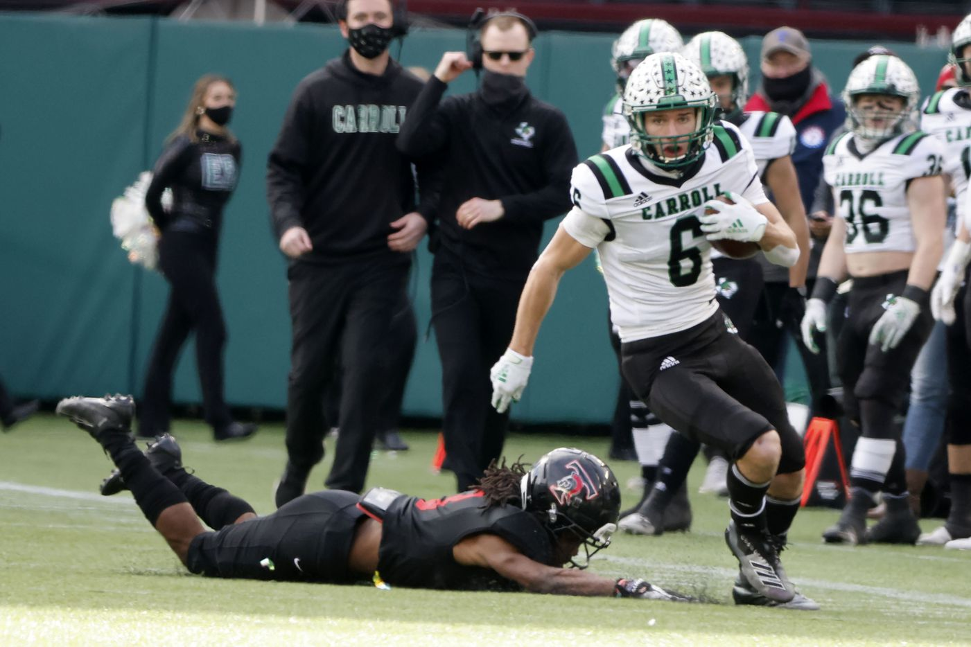 Southlake Carroll receiver Landon Samson (6) runs past Euless Trinity defender Cameron Andrews (3) during the Class 6A Division I Region I high school football final, in Arlington, Texas, on Jan. 2, 2020. (Michael Ainsworth/Special Contributor)