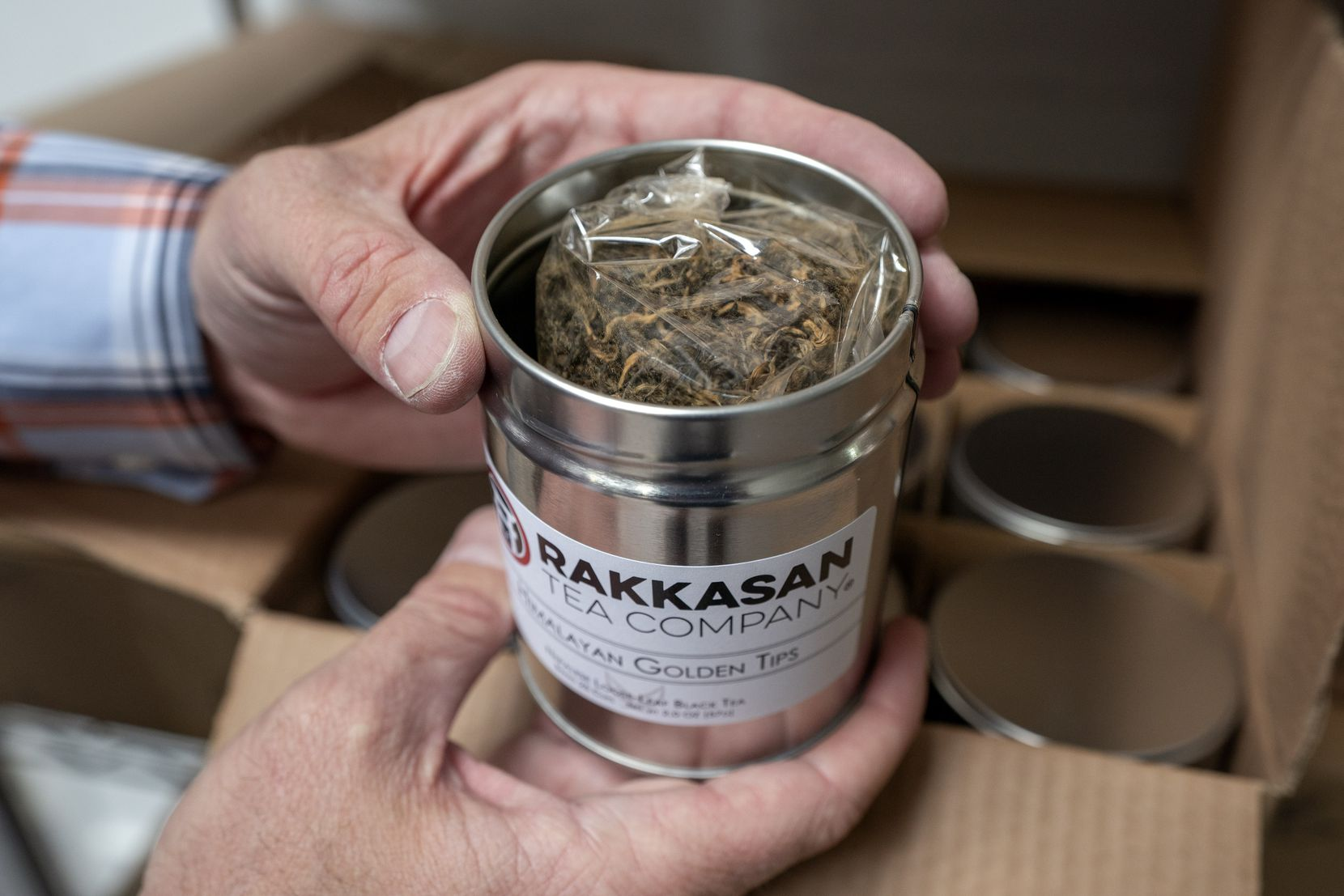 TK Kamauf holds a canister of Rakkasan Tea's Himalayan Golden Tips, his favorite tea.