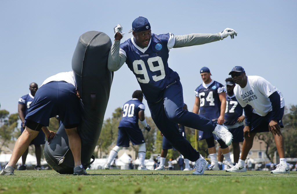 Dallas Cowboys defensive end Ryan Russell (99) hits a blocking dummy during a morning walk thru at training camp in Oxnard, California, Sunday, July 31, 2016. (Tom Fox/The Dallas Morning News)
