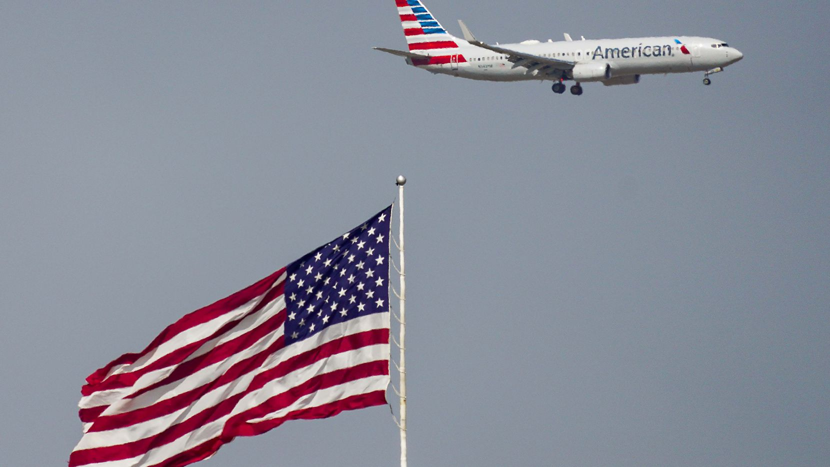 An American Airlines 737 descends for a landing at DFW International Airport on Tuesday, June 30, 2020.