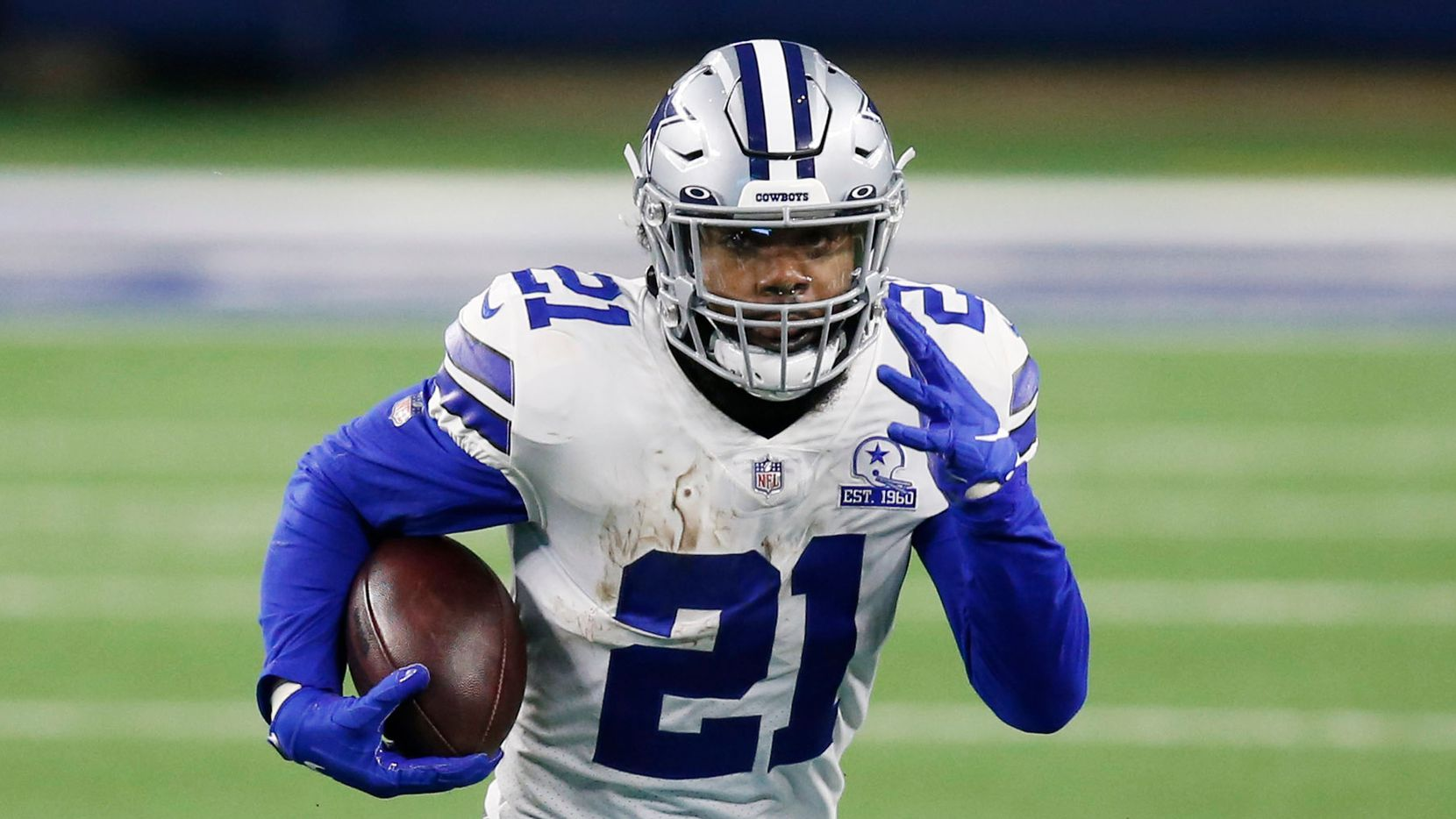 Dallas Cowboys running back Ezekiel Elliott (21) rushes up the field in a game against the Arizona Cardinals during the second quarter of play at AT&T Stadium on Monday, October 19, 2020 in Arlington, Texas.