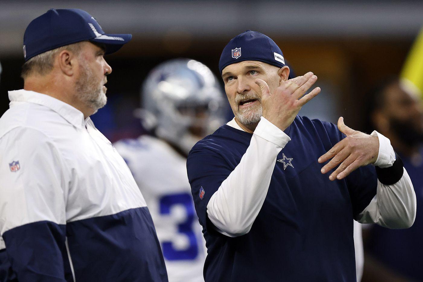 Dallas Cowboys head coach Mike McCarthy (left) listens to his defensive coordinator Dan Quinn during pregame warmups at AT&T Stadium in Arlington, Monday, September 27, 2021. (Tom Fox/The Dallas Morning News)