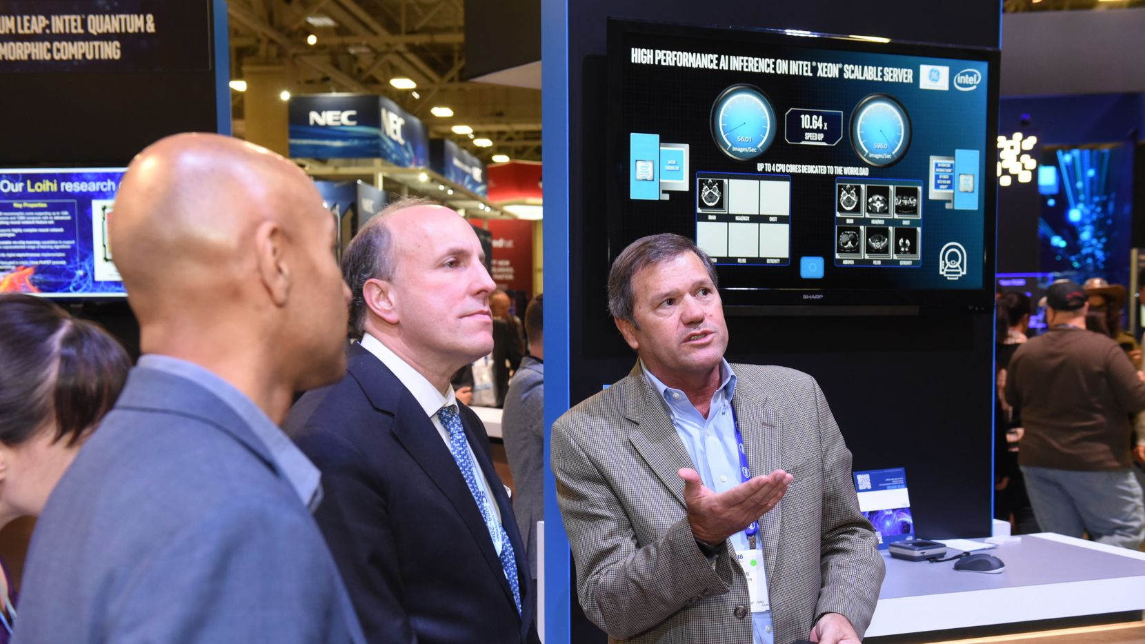 U.S. Department of Energy Undersecretary for Science Paul Dabbar (center) explores the exhibit hall at SC18 at the Kay Bailey Hutchison Convention Center.