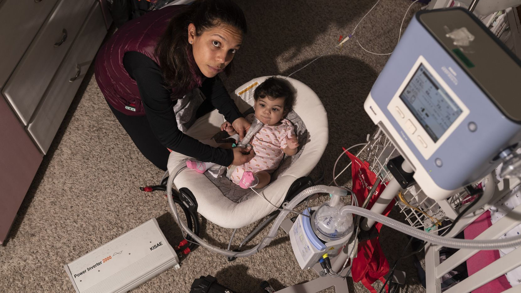 Said Rodriguez, 33, with her 1-year-old daughter Amanda Sedeño and the baby's breathing machine at her family's home in Plano, on Saturday, Feb. 27, 2021. Said lost access to water and electricity during last week's winter storm. She had to use a power converter connected to her car's battery to power her baby's breathing machine.