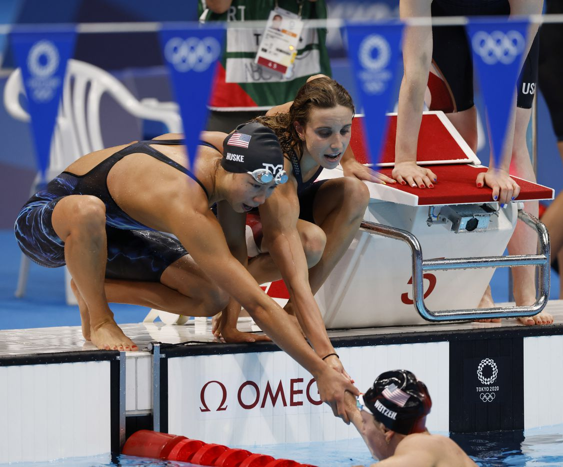 USA's Torri Huske and Regan Smith congratulate teammate Abbey Weitzeil after she finished the last leg of the women's 4x100 medley relay during the postponed 2020 Tokyo Olympics at Tokyo Aquatics Centre, on Sunday, August 1, 2021, in Tokyo, Japan. USA finished in second with a time of 3:51.60 to earn a silver medal. (Vernon Bryant/The Dallas Morning News)