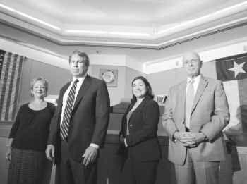 From left: Members of the conviction integrity unit  are paralegal Jena Parker, prosecutor Mike Ware, prosecutor Cynthia R. Garza and investigator James Hammond.