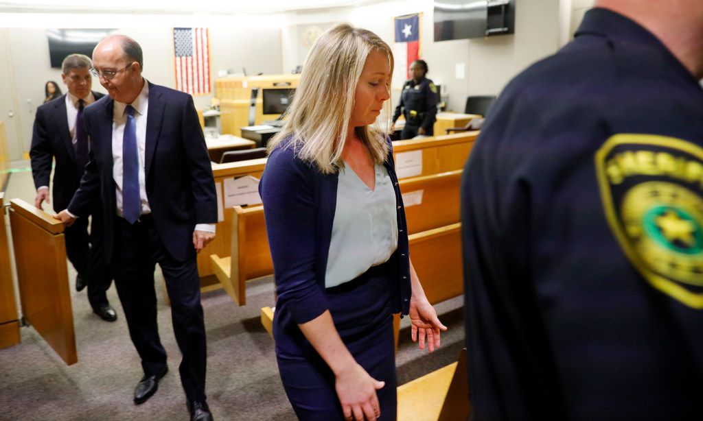 Amber Guyger was escorted from the courtroom Tuesday after she was found guilty of murder.