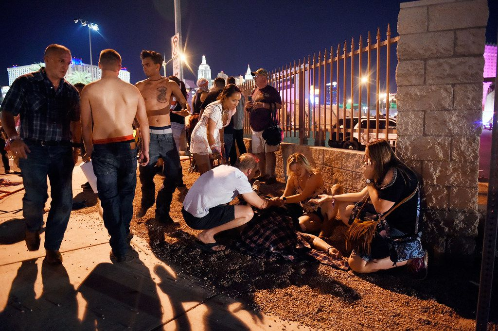 People tend to the wounded after an shooting Oct. 1 in Las Vegas.
