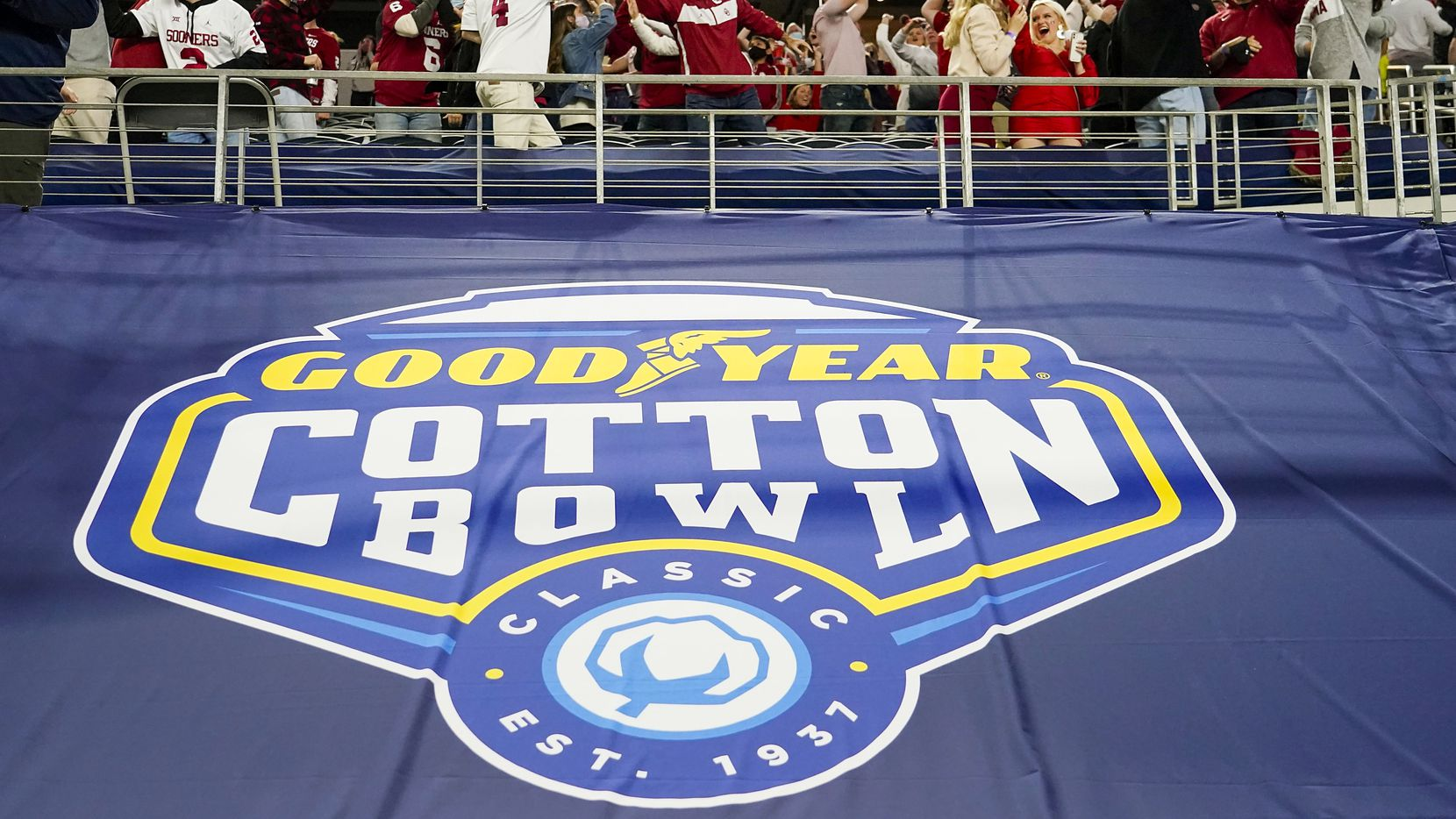 Oklahoma fans celebrate a Sooners touchdown during the first half of the Cotton Bowl Classic against Florida at AT&T Stadium on Wednesday, Dec. 30, 2020, in Arlington. (Smiley N. Pool/The Dallas Morning News)