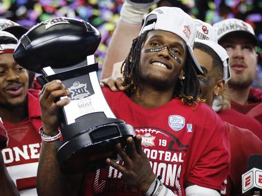 Oklahoma Sooners wide receiver CeeDee Lamb celebrates with the most outstanding player award following their Big 12 Championship win over the Baylor Bears at AT&T Stadium in Arlington, Saturday, December 7, 2019. Oklahoma won in overtime, 30-23. (Tom Fox/The Dallas Morning News)