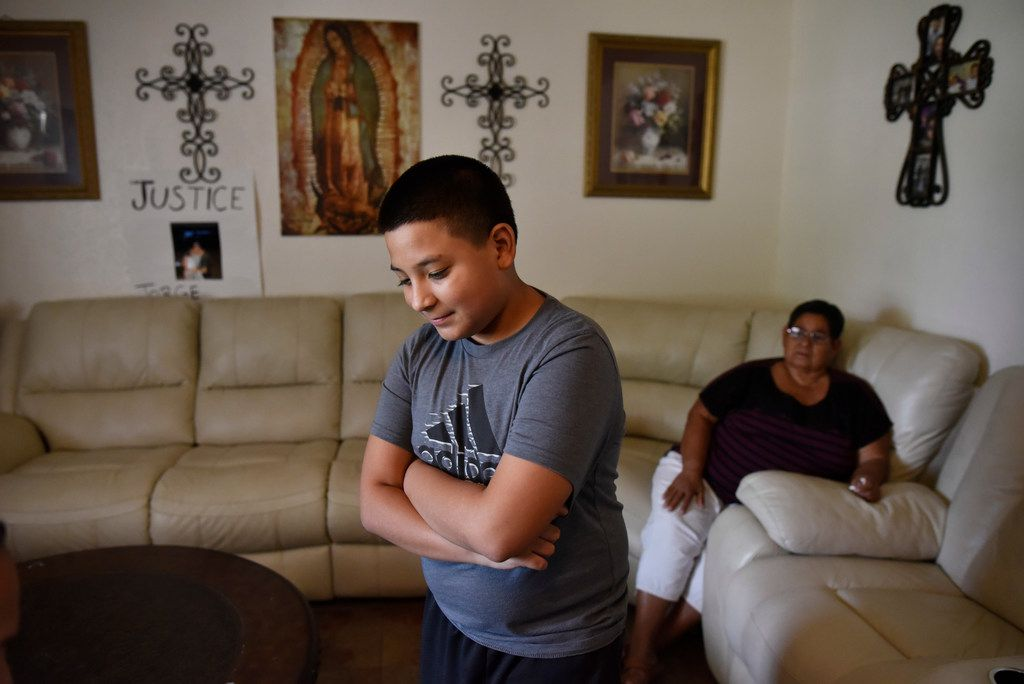 Jorge A. Olguín, 12, speaks about his father at the family's home in southern Dallas earlier this week.