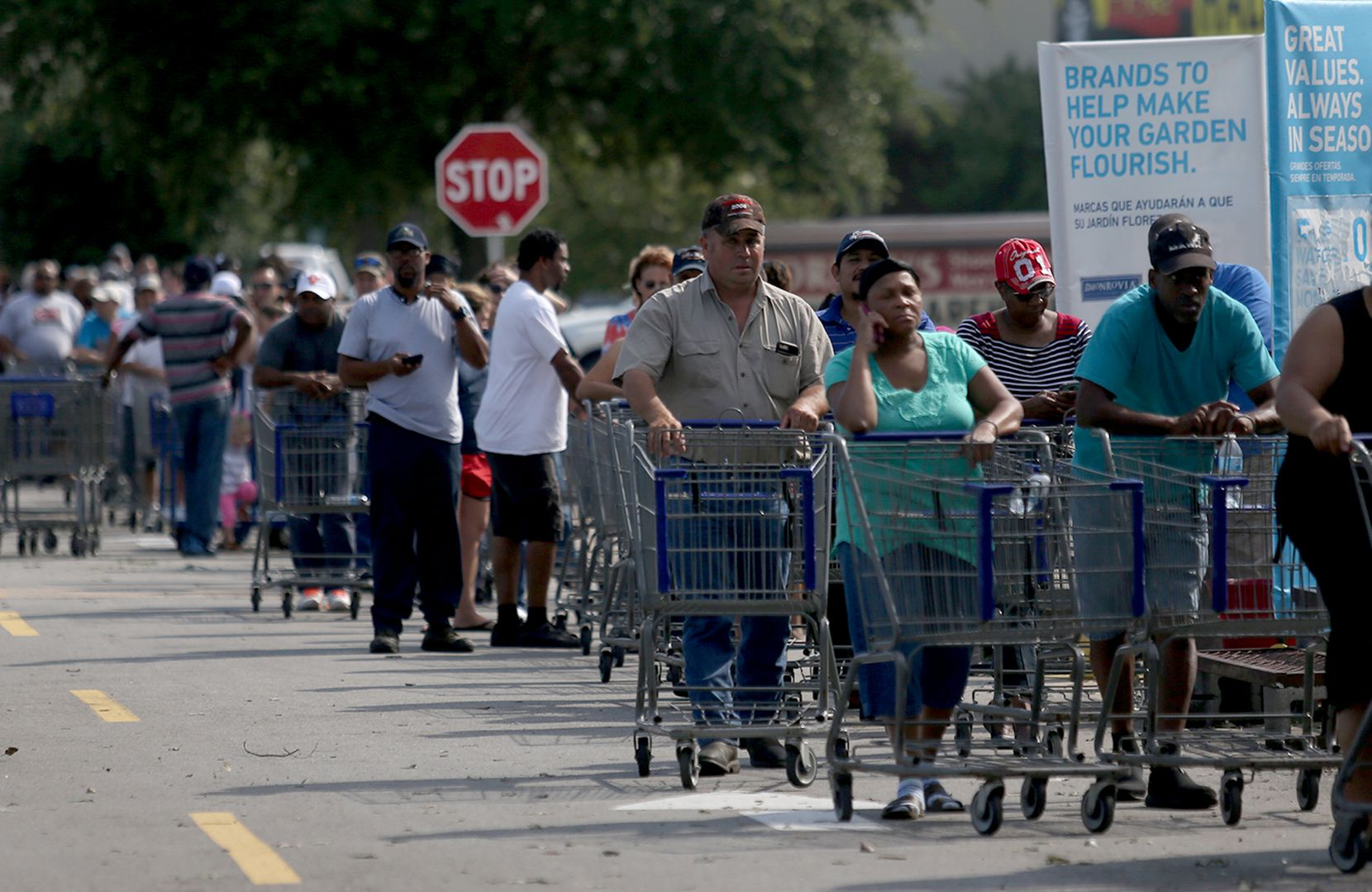 Residents wait hours in long lines at a Lowes, in Beaumont, Texas, August 31, 2017.
